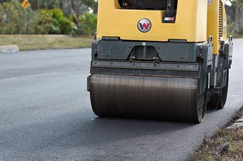 Asphalt Rolling machine hard at work |Collier Paving & Concrete